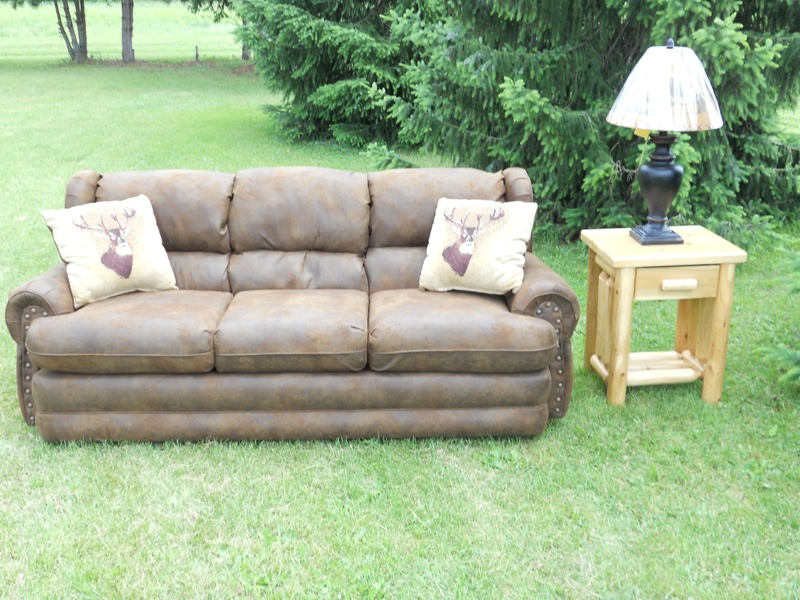 lodge sofa with deer pillows and log end table